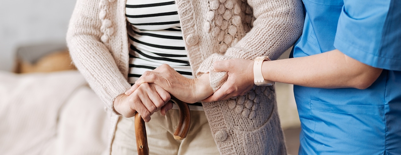 care home staff holding clients hands